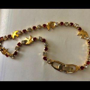 Brass bird ruby rhinestone tennis bracelet